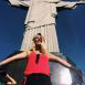 Specht with outstretched arms in front of Brazil's Jesus statue.