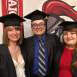 (Left to right) Tori, Ed, and Kate Knab in graduation robes and caps.