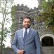 Arcadia President Ajay Nair outside Grey Towers Castle