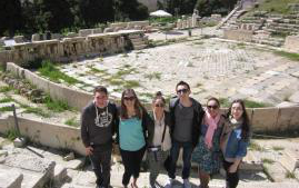 Students posing in front of Colloseum
